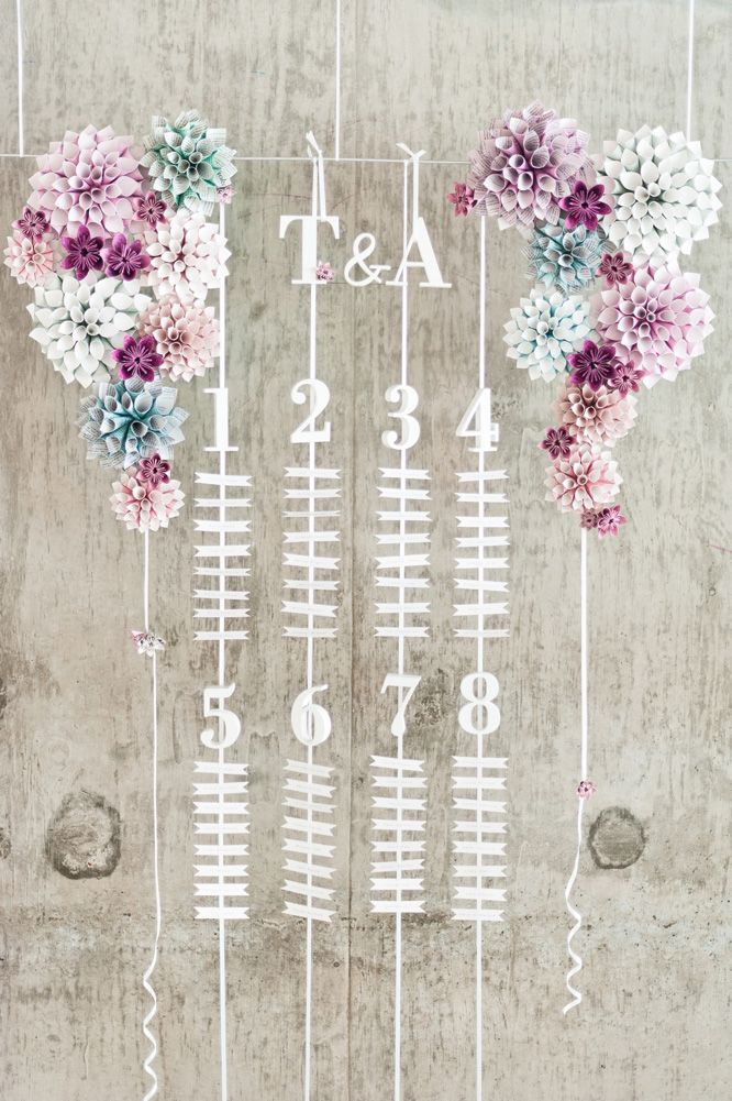 Suspended and hanging seating chart with paper cone flowers by eagle eyed bride Anushé Low Photography